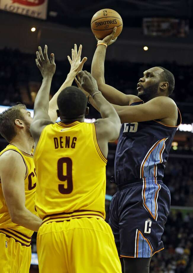 The Bobcats and Al Jefferson are on the rise over the Cavs' Luol Deng and Spencer Hawes in clinching a playoff berth. Photo: Mark Duncan, Associated Press
