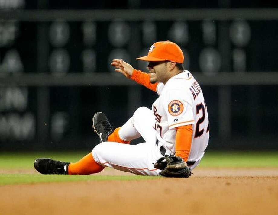 Jose Altuve reacts to missing a ground ball.
