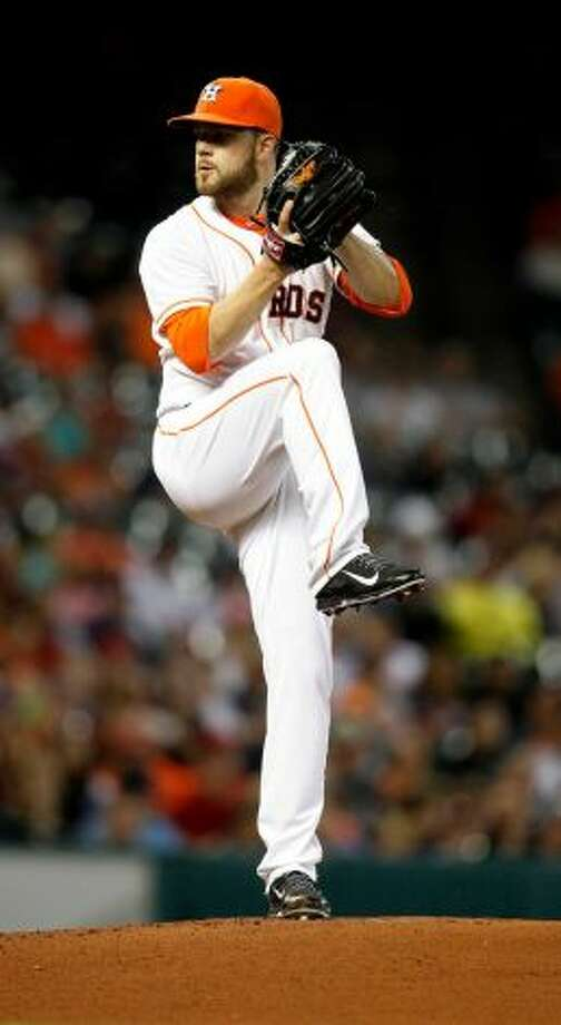 Dallas Keuchel pitches to the Angels.