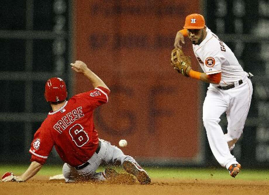 Jonathan Villar drops the ball while attempting to turn a double play.