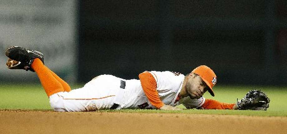 Jose Altuve just misses a ground ball.