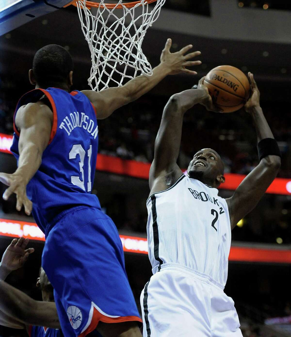 Brooklyn Nets' Kevin Garnett (2) shoots over Philadelphia 76ers' Hollis Thompson during the first half of an NBA basketball game on Saturday, April 5, 2014, in Philadelphia. (AP Photo/Michael Perez) ORG XMIT: PAMP101