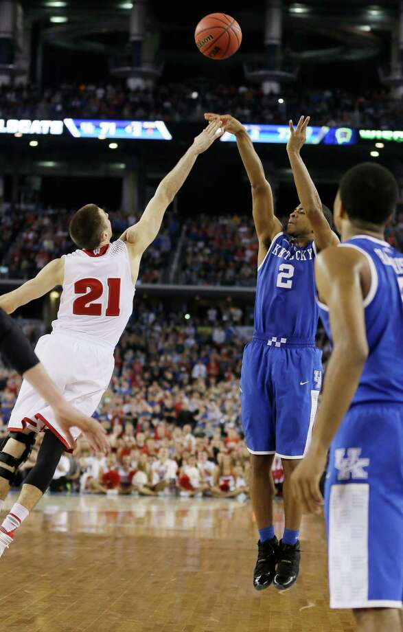 April 5: Final FourNo. 8 Kentucky 73, No. 2 Wisconsin 72Kentucky guard Aaron Harrison (2) makes a three-point basket in the final seconds over Wisconsin guard Josh Gasser (21) to win the game 74-73 during their NCAA Final Four tournament college basketball semifinal game Saturday, April 5, 2014, in Arlington, Texas. (AP Photo/Charlie Neibergall) Photo: Charlie Neibergall, Associated Press / AP