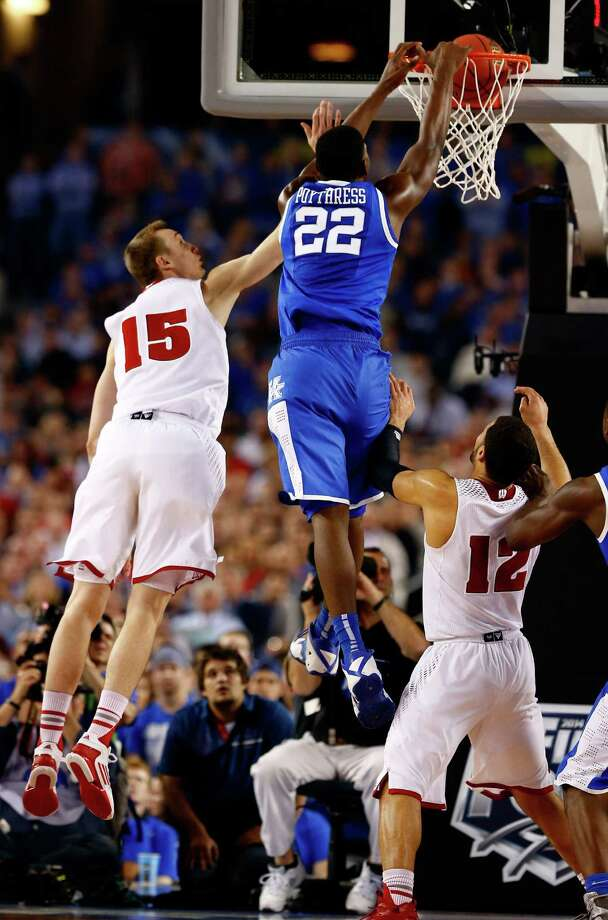 Alex Poythress powers past Wisconsin's Sam Dekker, left, to slam home two points for Kentucky during its 74-73 victory Saturday night. Photo: Tom Pennington, Staff / 2014 Getty Images