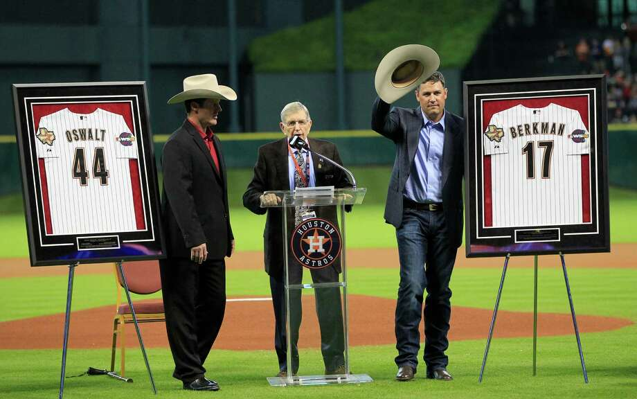 Retiring Astros icons Roy Oswalt, left, and Lance Berkman were honored by Milo Hamilton and the team in a pregame ceremony Saturday. C4 Photo: Karen Warren, Staff / © 2014 Houston Chronicle