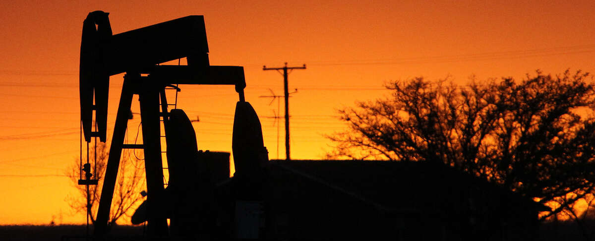 A pumpjack rocks back and forth as the sun sets Wednesday April 2, 2014 in Stanton, Texas. Oil exploration in the area has raised property values and many other rates much like in the Eagle Ford area.