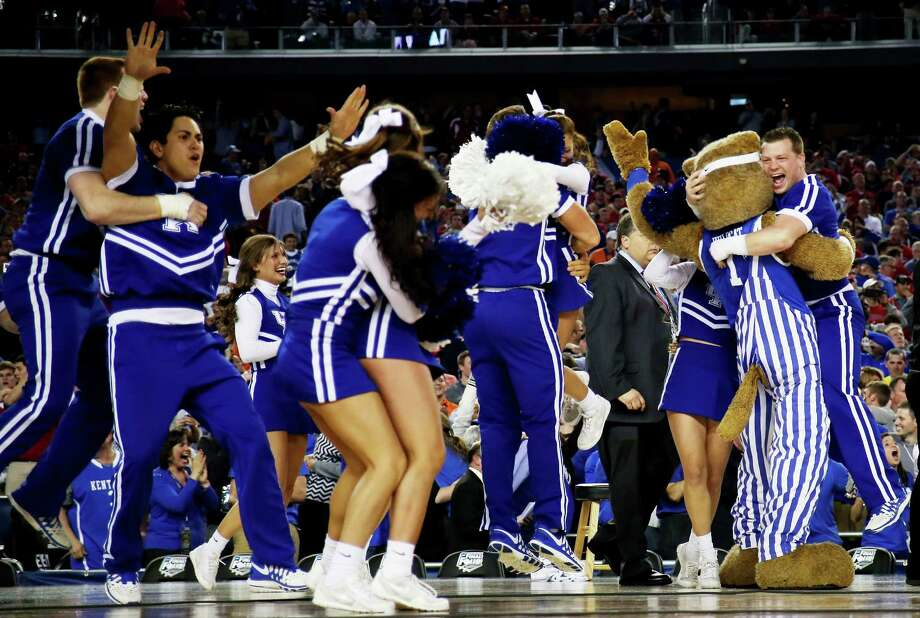 ARLINGTON, TX - APRIL 05: Kentucky Wildcats cheerleaders react after defeating the Wisconsin Badgers 74-73 in the NCAA Men's Final Four Semifinal at AT&T Stadium on April 5, 2014 in Arlington, Texas. Photo: Jamie Squire, Getty Images / 2014 Getty Images