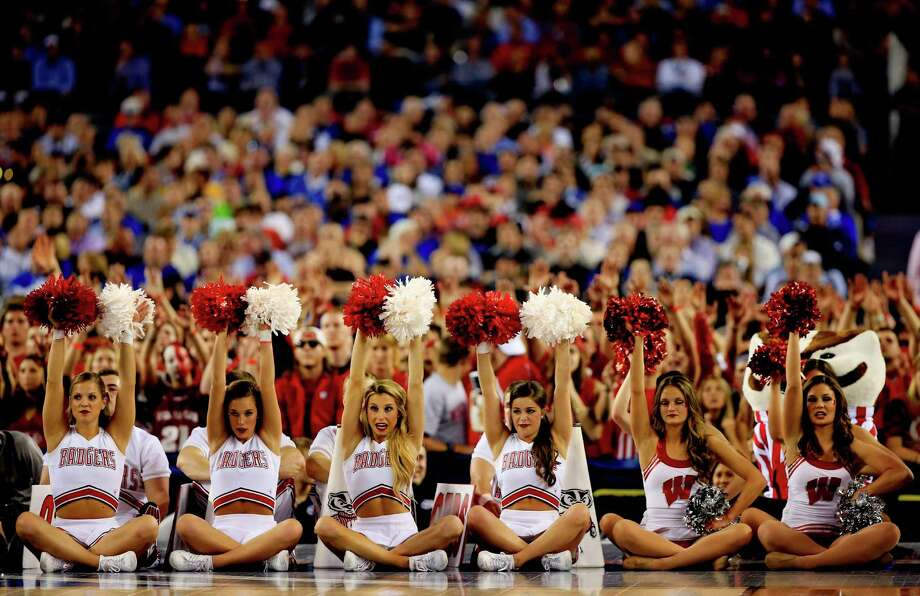 ARLINGTON, TX - APRIL 05: Wisconsin Badgers cheerleaders perform during the NCAA Men's Final Four Semifinal against the Kentucky Wildcats at AT&T Stadium on April 5, 2014 in Arlington, Texas. Photo: Jamie Squire, Getty Images / 2014 Getty Images