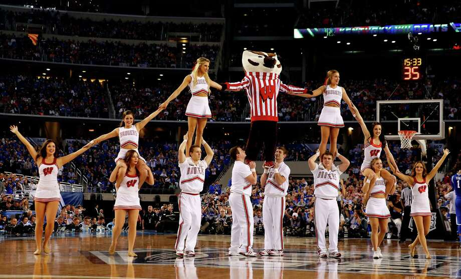 ARLINGTON, TX - APRIL 05: The Wisconsin Badgers cheerleaders perform during the NCAA Men's Final Four Semifinal against the Kentucky Wildcats at AT&T Stadium on April 5, 2014 in Arlington, Texas. Photo: Tom Pennington, Getty Images / 2014 Getty Images