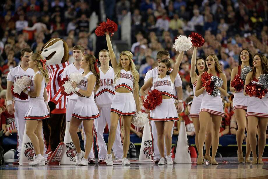 Wisconsin cheerleaders perform during the first half of an NCAA Final Four tournament college basketball semifinal game against Kentucky Saturday, April 5, 2014, in Arlington, Texas. (AP Photo/David J. Phillip) Photo: David J. Phillip, Associated Press / AP