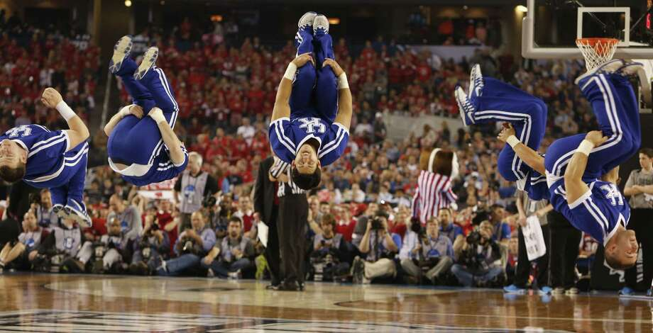 Kentucky cheerleaders flip during a timeout during first half action as the Kentucky Wildcats faced the Wisconsin Badgers in the second semifinal game of the Final Four at AT&T Stadium Saturday, April 5, 2014 in Arlington, Texas. (Richard W. Rodriguez/Fort Worth Star-Telegram/MCT) Photo: Richard W. Rodriguez, McClatchy-Tribune News Service / The Dallas Morning News