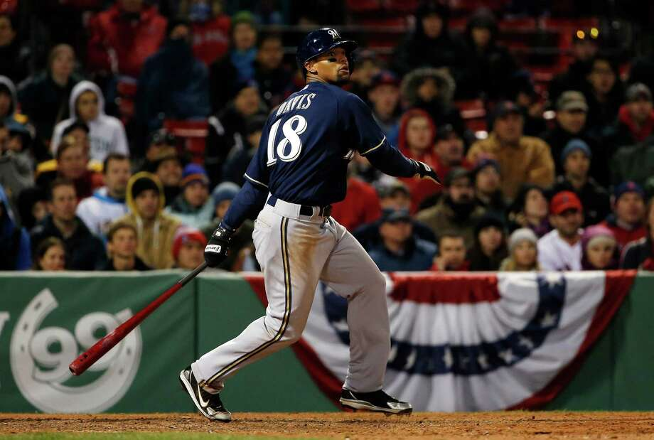 Milwaukee Brewers' Khris Davis watches his double against the Boston Red Sox during the eleventh inning of a baseball game at Fenway Park in Boston, Saturday, April 5, 2014. (AP Photo/Winslow Townson) ORG XMIT: BXF125 Photo: Winslow Townson / FR170221 AP
