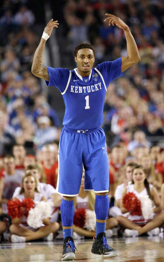 Kentucky guard James Young celebrates during the second half of an NCAA Final Four tournament college basketball semifinal game against Wisconsin Saturday, April 5, 2014, in Arlington, Texas. (AP Photo/David J. Phillip)  ORG XMIT: FF388 Photo: David J. Phillip / AP