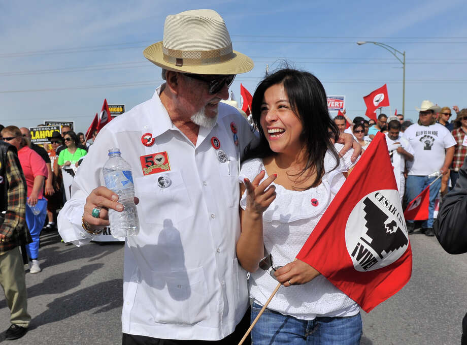 Cesar Chavez March organizer Jaime Martinez  walks with Chavez' grandaughter Christine Chavez during the march in 2014. Photo: For The San Antonio Express-News