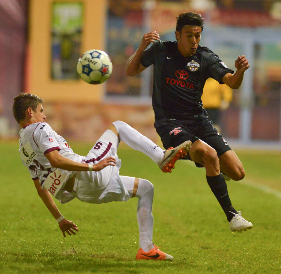 The Scorpions' Walter Restrepo (right) and Deportivo Saprissa's Luis Flores fight for control of the ball during the first half at Toyota Field on Saturday. Photo: Courtesy Photo