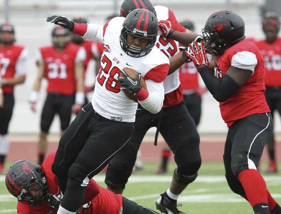 Tailback Junior Sessions (center) had a TD during Incarnate Word's spring game at Benson Stadium on Saturday. UIW has 10 starters back on offense. Photo: Kin Man Hui / San Antonio Express-News / ©2014 San Antonio Express-News