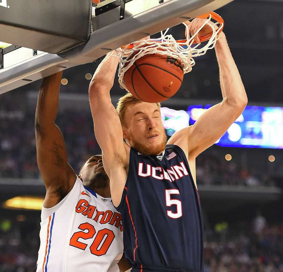 Connecticut's Niels Giffey dunks in front of Florida's Michael Frazier II (20) in the second half in Arlington. Photo: Harry E. Walker / McClatchy-Tribune News Service / The Dallas Morning News