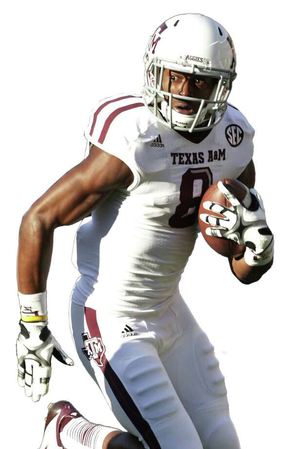 Johnson's mother vows he'll return to play football — but not at A&M. / AP
