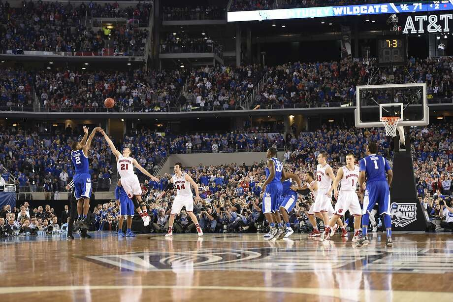 Aaron Harrison hits the game-winning three-pointer over Wisconsin's Josh Gasser. Photo: Bob Donnan, Reuters