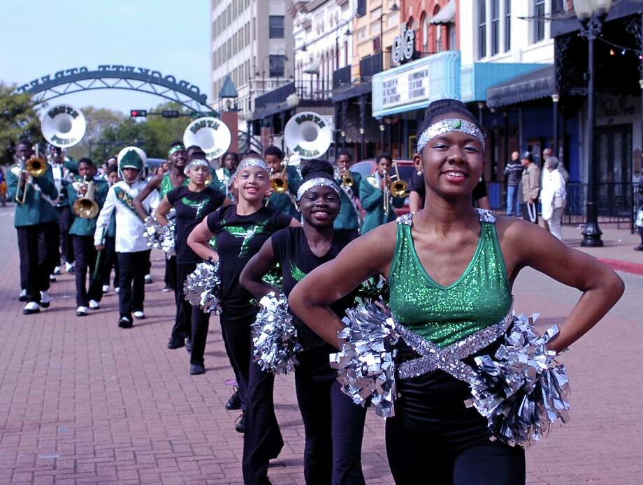 South Park Middle School dance team members strut their stuff on Crocket Street during the Neches River Festival Parade on Saturday in downtown Beaumont Photo: Sarah Moore