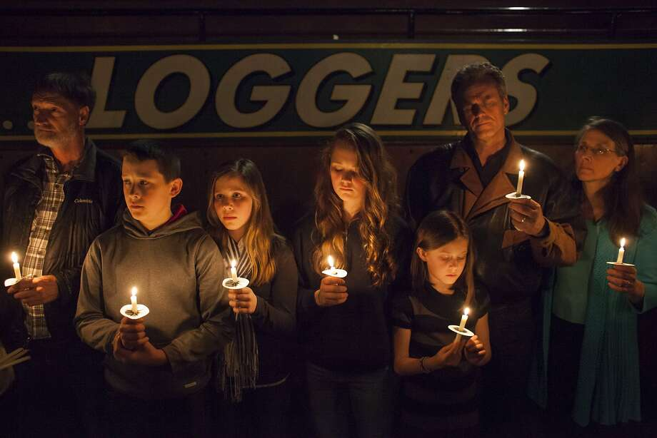 DARRINGTON, WA - APRIL 5: People hold candles during a vigil for mudslide victims at the Darrington Community Center on April 5, 2014 in Darrington, Washington. A March 22 mudslide killed at least 30 and left many missing. (Photo by David Ryder/Getty Images) Photo: David Ryder, Getty Images