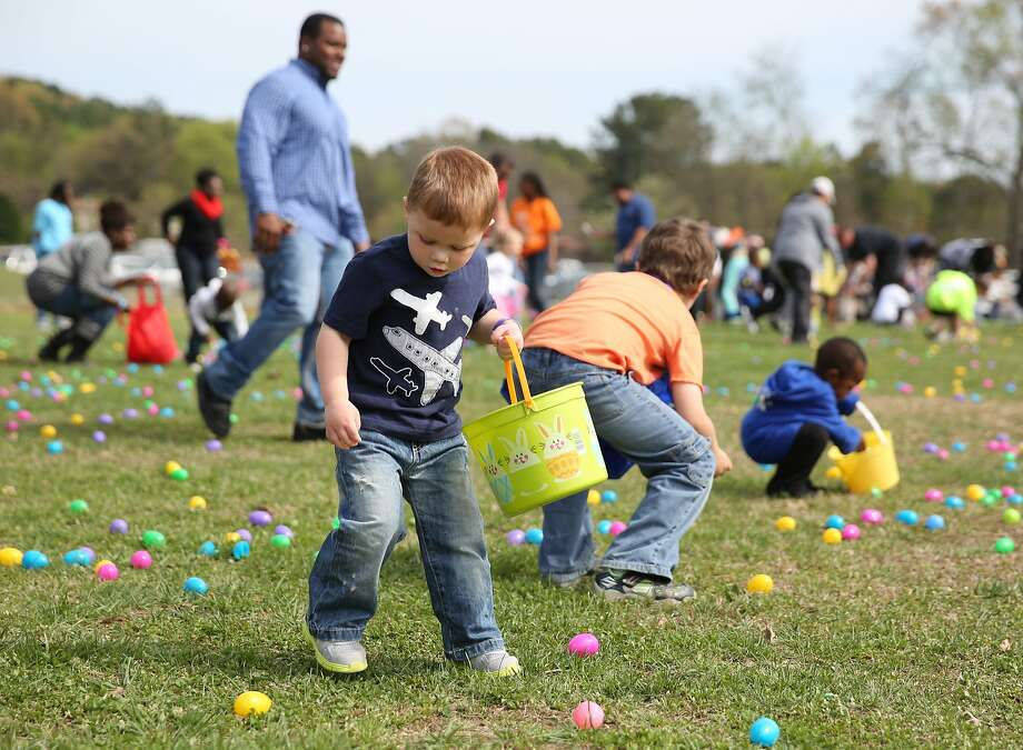 Ben Collett, 3, eyes an egg to pick up during the Easter egg hunt at Camp Jordan Park in East Ridge, Tenn., on Saturday, April 5, 2014. The event was put on by Venue Church. (AP Photo/Chattanooga Times, Erin O. Smith) Photo: Erin O. Smith, Associated Press
