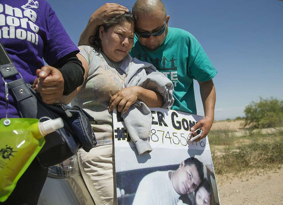 Anselma Lopez, is consoled by Miguel Guerra outside the immigration detention center in Eloy, Ariz., during a protest of the record numbers of deportations that have taken place under President Barack Obama's administration on Saturday, April 5, 2014. Anselma Lopez, has been fighting to bring home her son, Elder Gomez-Lopez, who is been at Eloy Detention Center for past 2 1/2 years. (AP Photo/The Arizona Republic,Nick Oza )  MARICOPA COUNTY OUT; MAGS OUT; NO SALES Photo: Nick Oza, Associated Press