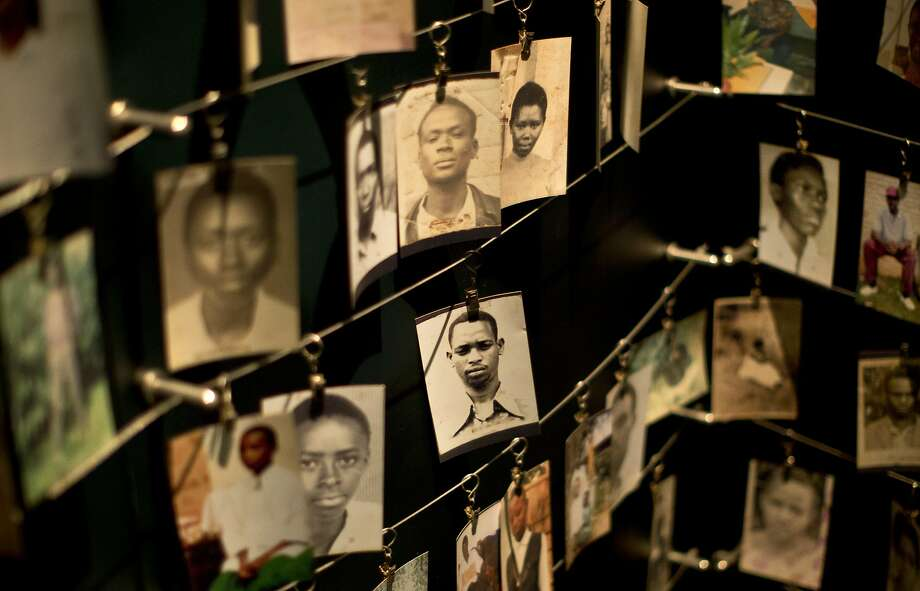 Family photographs of some of those who died hang in a display in the Kigali Genocide Memorial Centre in Kigali, Rwanda Saturday, April 5, 2014. The country will commemorate on April 7, 2014 the 20th anniversary of the genocide when ethnic Hutu extremists killed neighbors, friends and family during a three-month rampage of violence aimed at ethnic Tutsis and some moderate Hutus, leaving a death toll that Rwanda puts at 1,000,050. (AP Photo/Ben Curtis) Photo: Ben Curtis, Associated Press