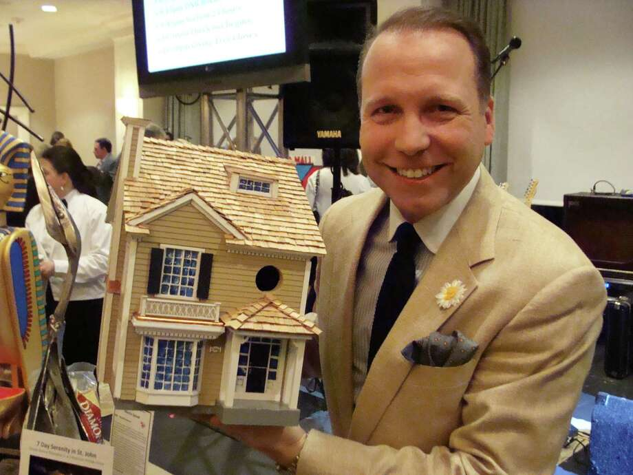 Author/designer Mar Jennings of Westport was the successful bidder on a birdhouse that is an exact replica of his Westport residence at the Project Return auction on Saturday. The birdhouse was created by custom home builder and real estate developer Rick Benson, who constructed Jennings' house, Rosebrook Garden, in 1996. Photo: Meg Barone / Westport News