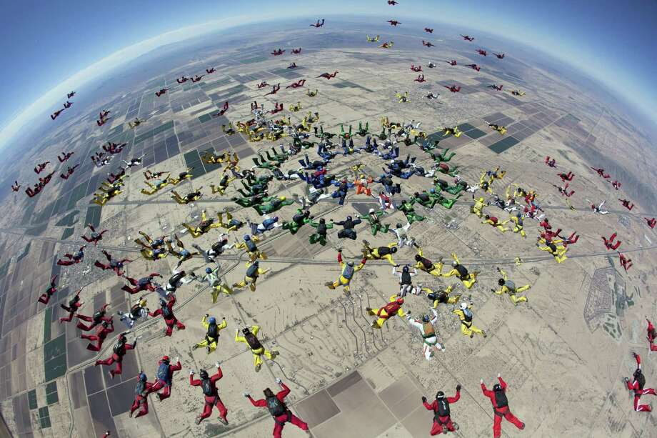 In this  Tuesday, April 1, 2014 photo provided by The World Team, a group of 222 skydivers from 28 nations, team members dive over Eloy, Ariz. The jump was part of the group's ongoing attempt to set a world record by forming two distinct aerial formations within the same dive. The team did not break the record with this attempt. Photo: Andrey Veselov Cop, AP  / AP2014