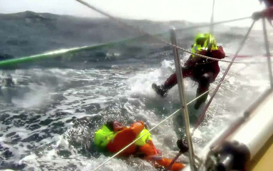 This Monday, March 31, 2014 image provided by clipperroundtheworld.com shows Andrew Taylor, 46, left, from London during his rescue after falling overboard from the 70-foot yacht, the Derry-Londonderry-Doire, during the Clipper Round the World Yacht Race. Taylor spent nearly two hours in the cold, rough North Pacific and says he never gave up hope of being rescued because he knew his fellow crew members were well-trained for such an emergency. Photo: Uncredited, AP  / AP2014