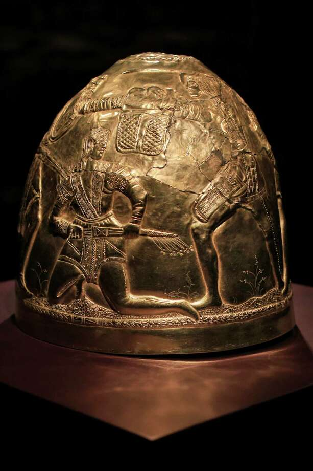 A Scythian gold helmet from the fourth century B.C. is displayed as part of the exhibit called The Crimea - Gold and Secrets of the Black Sea, at Allard Pierson historical museum in Amsterdam Friday April 4, 2014. The museum has gotten more than the bronze swords, golden helmets and precious gems it bargained for as it is unsure where to return the collection after Russia annexed Crimea. Photo: Peter Dejong, AP  / AP