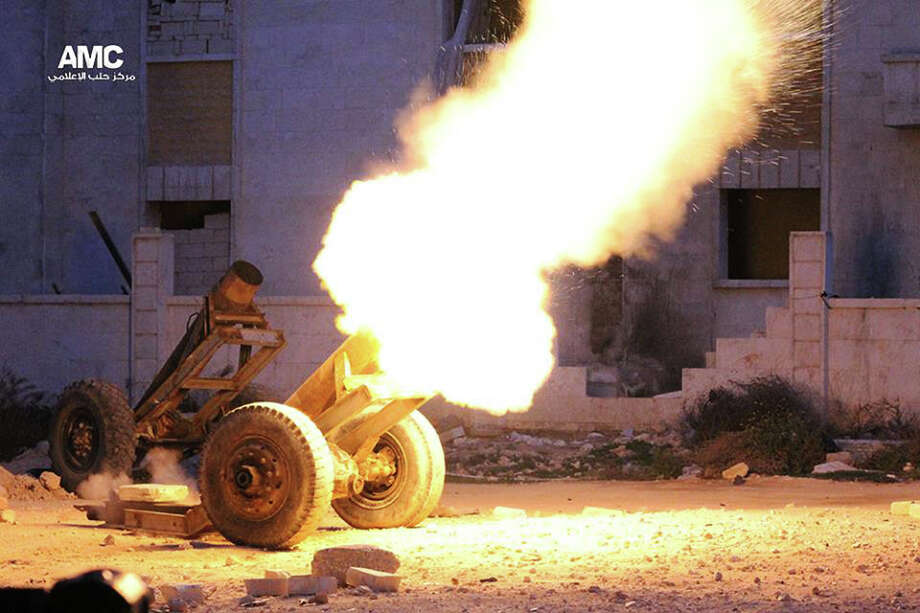 "This Wednesday April 2, 2014, photo provided by the anti-government activist group Aleppo Media Center (AMC), an anti-Bashar Assad activist group, which has been authenticated based on its contents and other AP reporting, shows locally made shells which rebels call a ""Hell Cannon,"" is fired by rebels against the Syrian government forces, in Aleppo, Syria. Photo: Uncredited, AP  / AP2014"