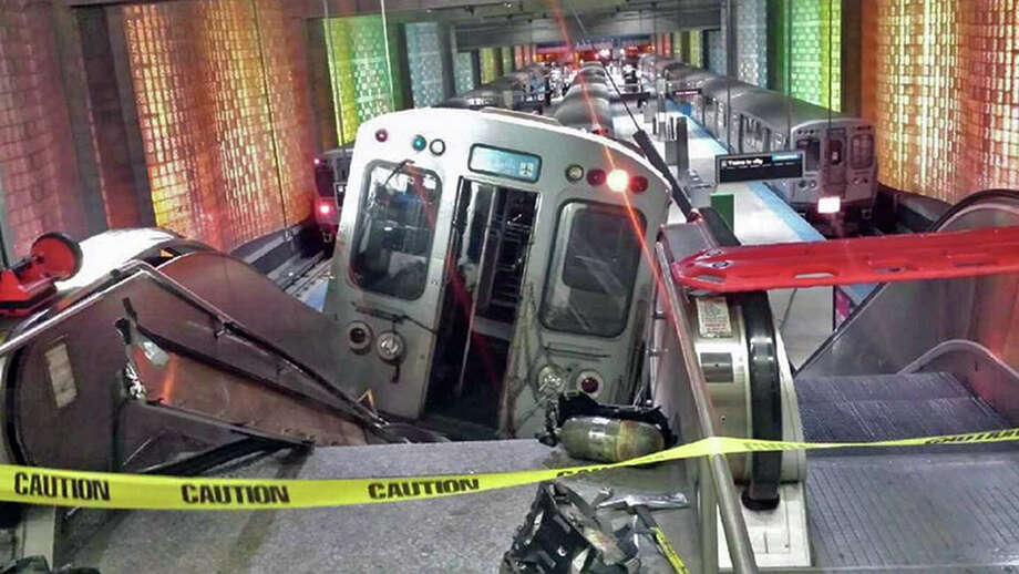 In this March 24, 2014 file photo a Chicago public-transit train rests on an escalator after it jumped the tracks at Chicago's O'Hare International Airport station. Chicago transit officials say the train operator who acknowledged dozing off before the crash was fired Friday, April 4, 2014. 30 passengers were injured in the crash. (AP Photo/NBC Chicago, Kenneth Webster)  Photo: Kenneth Webster, AP  / NBC Chicago