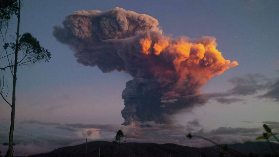 The Tungurahua volcano spews a column of ash as seen from Ambato, Ecuador, Friday, April 4, 2014. The volcano spewed a 6-mile (10-kilometer) column of ash after a powerful five-minute explosion that shot pyroclastic material onto its northern and northwestern flanks. Photo: Uncredited, AP  / AP2014