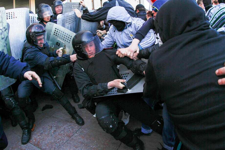 Pro-Russian demonstrators clash with police at the regional administration building in Donetsk, Ukraine. Photo: Andrey Basevich, Associated Press