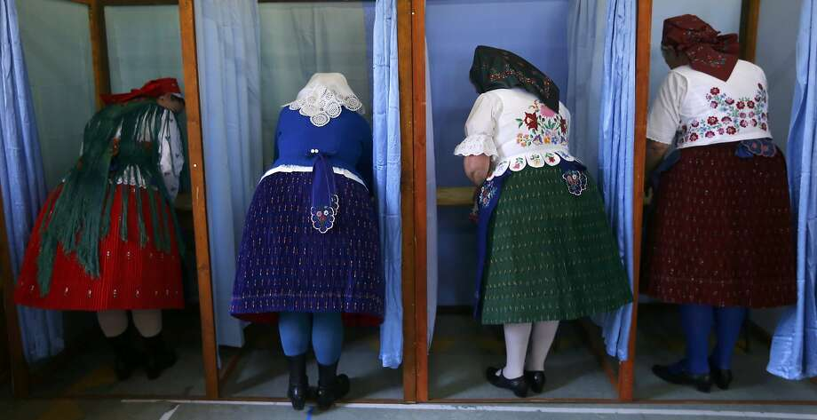 Hungarian women cast ballots in Veresegyhaza near Budapest. The Fidesz party of Prime Minister Viktor Orban, who secured a third term, won. Photo: Laszlo Balogh, Reuters