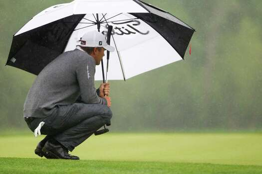 Matt Jones studies the green on the eighth hole under the rain during the championship round of the Shell Houston Open at the Golf Club of Houston, Sunday, April 6, 2014, in Humble. Photo: Marie D. De Jesus, Houston Chronicle / © 2014 Houston Chronicle