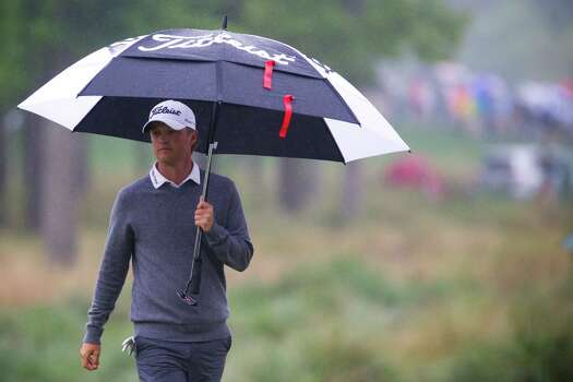Matt Jones of Australia walks to the 9th hole green under the rain during the championship round of the Shell Houston Open at the Golf Club of Houston, Sunday, April 6, 2014, in Humble. Photo: Marie D. De Jesus, Houston Chronicle / © 2014 Houston Chronicle