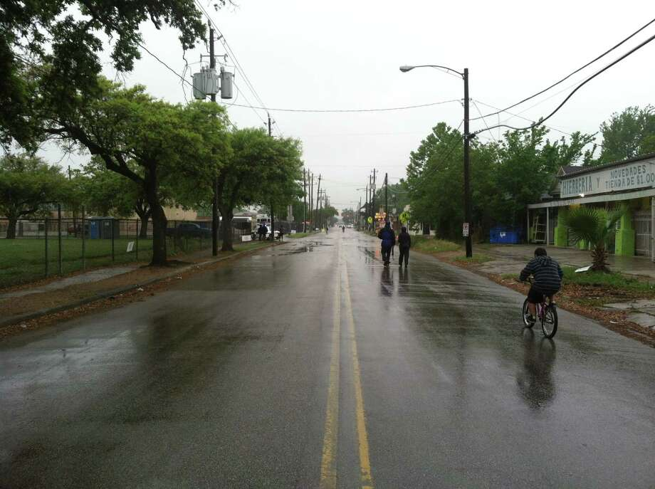 Until the day warmed up and rain moved on, few people attended the City of Houston's Sunday Streets event, which closed a more than two mile stretch of White Oak and Quitman to vehicle traffic for four hours. By 1 pm, officials reported more than 2,000 people filled the street. Photo: Jayme Fraser, Houston Chronicle