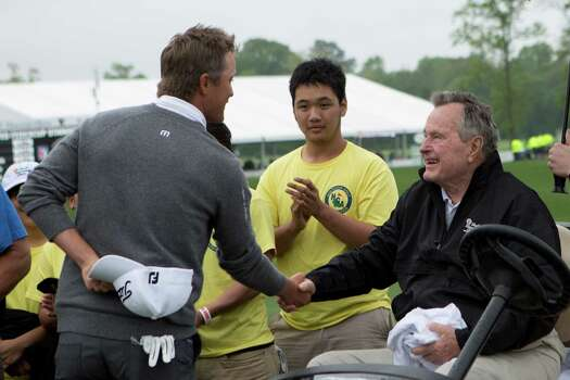 Former Unites States President George H. W. Bush shakes hands with matt Jones, the winner of the Shell Houston Open, Sunday, April 6, 2014, in Humble. Photo: Marie D. De Jesus, Houston Chronicle / © 2014 Houston Chronicle