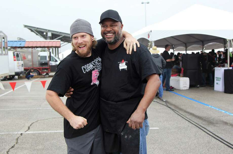 Will Buckman, of Corkscrew BBQ, and Jamie Fain, of Fainous BBQ, greet each other during The 2nd Annual BBQ Cook Off on April 6,  2014, in Houston, Tx. The Houston Barbecue Festival is to celebrate and recognize owners and pit masters that make Houston barbecue unique. Photo: Mayra Beltran, Houston Chronicle / © 2014 Houston Chronicle