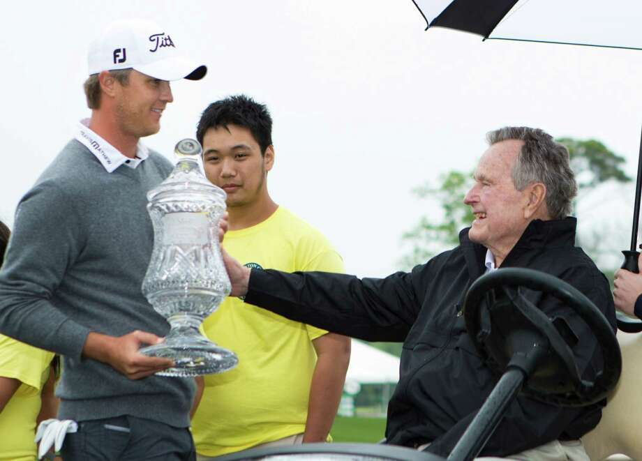 Matt Jones the winner of 2014 Shell Houston Open brings the trophy to former Unites States President George H. W. during the championship round at the Shell Houston Open, Sunday, April 6, 2014, in Humble. Photo: Marie D. De Jesus, Houston Chronicle / © 2014 Houston Chronicle