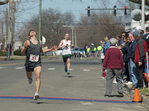 Competitors in the Greater Danbury Road Races, Half Marathon and 5K, and the United Savings Bank Kids Run, on Sunday, April 6, 2014, in Danbury, Conn. All the races started and finished in front of the Danbury War Memorial. Photo: H John Voorhees III / The News-Times Freelance