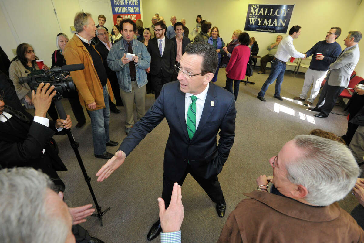 Gov. Dannel P. Malloy greets supporters during the governor's campaign kickoff party at the Democratic City Committee headquarters in Stamford, Conn., on Sunday, April 6, 2014.