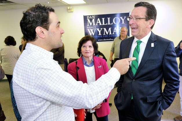 John Louizos chats with Gov. Dannel P. Malloy during the governor's campaign kickoff party at the Democratic City Committee headquarters in Stamford, Conn., on Sunday, April 6, 2014. Photo: Jason Rearick / Stamford Advocate