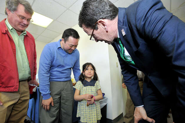 Gov. Dannel P. Malloy greets State Rep. William Tong and his daughter, Penelope Tong, during the governor's campaign kickoff party at the Democratic City Committee headquarters in Stamford, Conn., on Sunday, April 6, 2014. Photo: Jason Rearick / Stamford Advocate