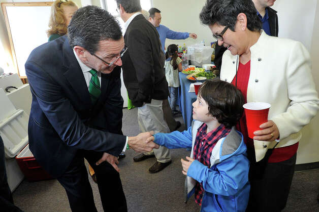 Gov. Dannel P. Malloy greets Silvia Fernandez-Stein and her grandson Mateo Smith-Stein during the governor's campaign kickoff party at the Democratic City Committee headquarters in Stamford, Conn., on Sunday, April 6, 2014. Photo: Jason Rearick / Stamford Advocate