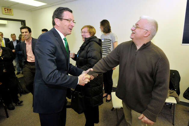 Gov. Dannel P. Malloy greets Jon Gallup during the governor's campaign kickoff party at the Democratic City Committee headquarters in Stamford, Conn., on Sunday, April 6, 2014. Photo: Jason Rearick / Stamford Advocate