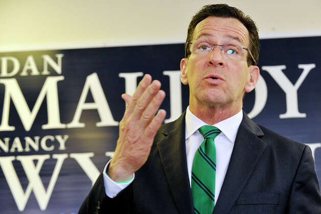 Gov. Dannel P. Malloy addresses a crowd of supporters during the governor's campaign kickoff party at the Democratic City Committee headquarters in Stamford, Conn., on Sunday, April 6, 2014. Photo: Jason Rearick / Stamford Advocate